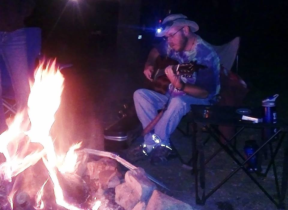 Playing Acoustic Guitar at a Campfire